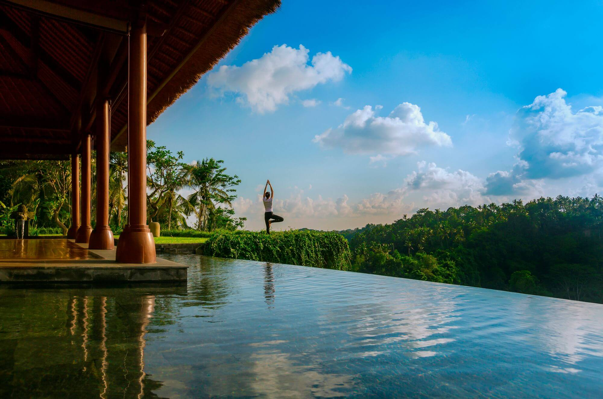 practicing yoga at Ritz-Carlton Mandapa Ubud Bali